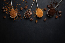 Coffee In Different Spoons On Dark Background
