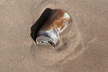 Rusty Can Buried In The Desert Sand. Environment, Recycling, Garbage Concept
