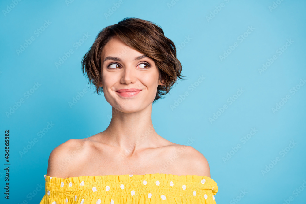 Leinwandbild Motiv - deagreez : Photo portrait of woman looking at blank space isolated on vivid blue colored background
