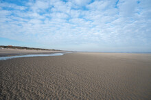 Low Tide Period On Yellow Sandy Beach In Small Belgian Town De Haan Or Le Coq Sur Mer, Luxury Vacation Destination, Summer Holidays