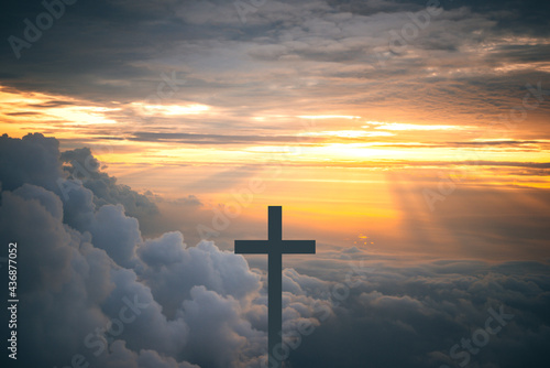 Leinwand Poster The Cross at the sky background