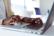 Close Up Of Hands Of African American Businesswoman Using Laptop