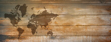 World Map On Old Wooden Wall Background. Horizontal Banner