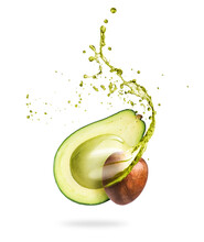 Half Of Sliced Avocado With Splashes Of Juice Close-up, Isolated On A White Background