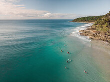 Aerial View Of Surfers With Colourful Surfing Boards In Noosa, Queensland, Australia.