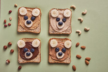 Funny Children Bear Toasts With Nuts Butters For Breakfast
