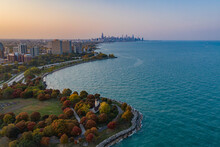 Aerial View Of Promontory Point Along The Lake Michigan, View Of Chicago Downtown In Background At Sunset, Chicago, Illinois, United States.