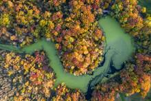 Aerial View Of A Narrow Stream Near Mathiessen Lake In Autumn Near Oglesby, Illinois, United States.