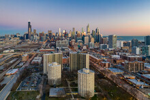 Aerial View Of Chicago Residential District Near Park No. 540 With City Skyline In Background At Sunset, Chicago, Illinois, United States.