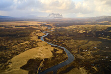 Aerial View Of A Waving River Streaming Through The Valley In Spring Time During Sunset, Rangárbing Ytra, Southern, Iceland.