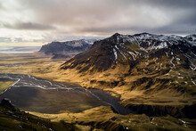 Aerial View Of A Beautiful Landscape With High Mountains And An Endless Valley Along The Ocean At Sunset, Rangáring Eystra, Southern, Iceland.