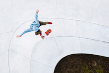 Aerial View Of Professional Skateboarder Jumping And Doing Kick Flip Trick In Urban Skate Park In Kaunas, Lithuania.