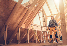 Professional Construction Worker Inside Newly Built Wooden Frame House