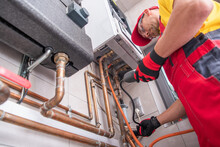 Professional Gas Heating Technician With Gas Detector