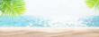 Leinwandbild Motiv Sea beach with hot sand, palm leaves and sunny bokeh