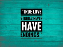 """Love Quote,"""" True Love Stories Never Have Endings. """"with Green Wooden Background"""