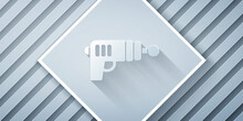 Paper Cut Ray Gun Icon Isolated On Grey Background. Laser Weapon. Space Blaster. Paper Art Style. Vector