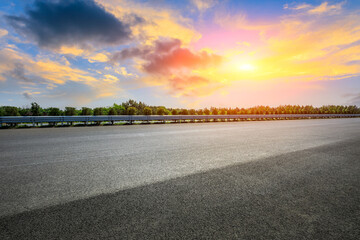 Asphalt highway and beautiful sky cloud scenery at sunset.