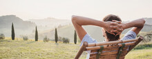 Young Man Looking At The Valley In Tuscany, Italy, Relaxation, Vacations, Lifestyle, Summer Fun, Have A Good Day, Enjoying Life Concept. Panoramic Banner.