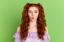 Photo Of Cute Red Hairstyle Millennial Lady Do Funny Face Wear Violet Blouse Isolated On Green Color Background