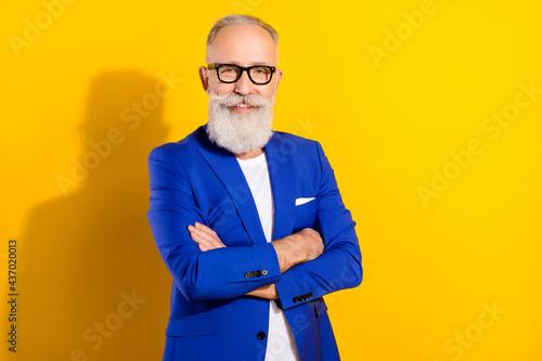 Fototapeta Photo portrait of senior man in blue suit glasses smiling with crossed hands iso