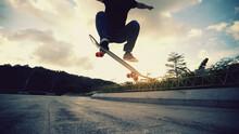 Skateboarder Skateboarding Outdoors In The Morning