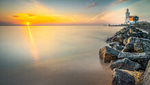 Horse Of Marken Lighthouse During Sunrise. Marken Is A Small Fishing Village On The Coast