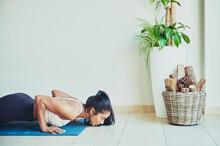 Ethnic Sportswoman Performing Plank Pose On Mat