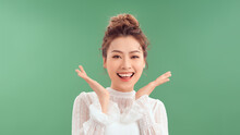 Attractive Lady Arms Hold Chin Head Smiling Overjoyed Look Side Empty Space Isolated Green Color Background