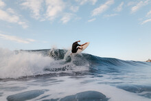 Unrecognizable Athlete Practicing Surfing On Ocean Wave