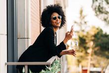 Stylish Black Woman In Trendy Sunglasses Using Smartphone