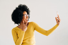 Black Cheerful Woman Showing Victory Gesture And Taking Selfie