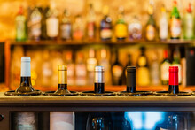 Bottles Of Wine Placed On Counter In Bar