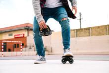Unrecognizable Man Doing Stunts With Freeline Skates Soccer Field