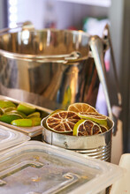 Lime Slices Heaped In Metal Jars On Bar Counter