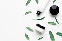 Cosmetic Containers With Cream And Lotion, Herbal Sage Leaves On White Background Flat Lay Top View. Cosmetics SPA Branding Mock-up. Natural Beauty Organic Product Concept. Blank Label For Branding