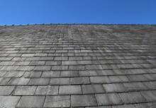 A Close Up View Of Some Traditional Slate Tiles On A Roof In Wales, UK.