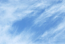 Cirrostratus Cloud In High Blue Sky. A Fluctuation Weather Make A Dreamy And Imaginative Cloudscape. Soft And Flow Of Cloud In Vast Nature Summer Background.