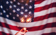 Sparklers  And American Flag. Independence Day USA . Celebration 4th Of July - Patriotic Holiday.
