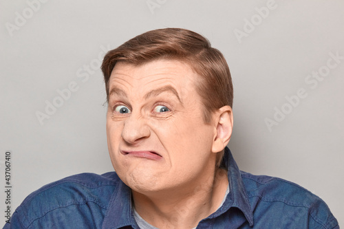Canvas Print Portrait of funny man grimacing and making goofy crazy face