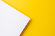 Yellow And White Colored Paper With Shadows As Background, Top View, Space For Text, Flat Lay