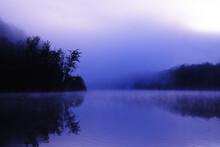Magical Morning Fog Over A Lake