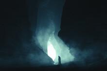 Silhouette Of A Woman In Cloak In Dark Cave
