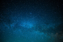 Milky Way. A Beautiful Night Sky With Bright Stars Sparkling. Beautiful Shades Of Blue. Minimalism. No People. Background. Texture, Wallpaper. There Is A Place For Your Insert.