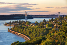 Tacoma Narrows Bridge Taken From The South With A Train Headed North During A Sunset