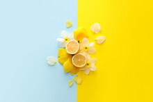 Beautiful Composition With Flowers And Cut Lemon On Color Background