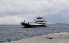 A Large Ferry Is Approaching The Shore To Disembark Passengers On A Cloudy Spring Day. Sea Transport Transportation On Large Ships