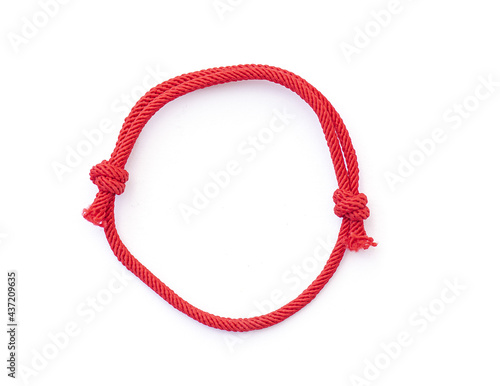 Fotografia Red thread, string as amulet for wrist isolated on white