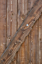Brown Wooden Door Made From Shabby Planks With A Diagonal Plank. Wooden Door To The Wine Cellar.