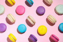 Delicious Colorful Macarons On Pink Background, Flat Lay